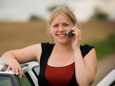 Lady calling for car towing